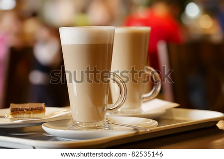 coffee latte in two tall glasses, shallow dof - stock photo