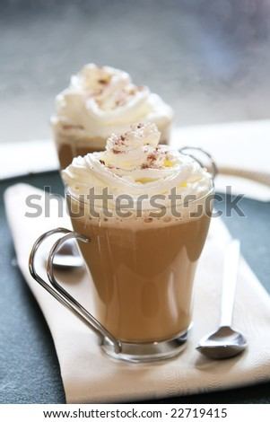 coffee latte macchiato with cream in glasses , shallow DOF - stock photo