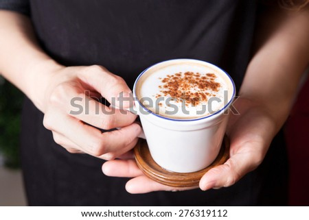 Coffee latte making by barista - stock photo