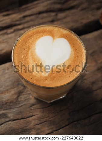 coffee latte on the wood desk vintage color tone - stock photo