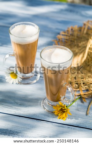 Coffee latte served in a sunny day - stock photo