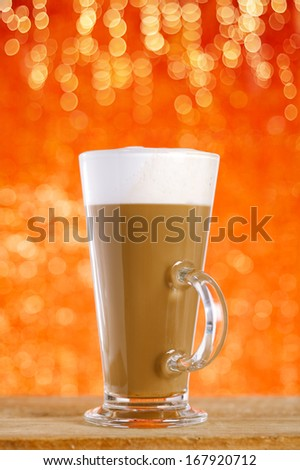 coffee latte with red glitter backdrop, shallow dof - stock photo