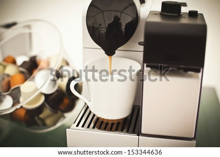 Coffee machine preparing espresso