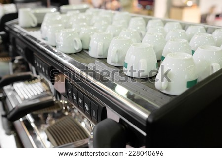 coffee-machine under the white background - stock photo