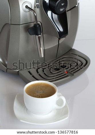 Coffee machine with a cup of coffee.