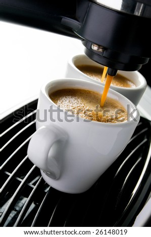 Coffee maker pouring hot espresso coffee in two cups. Take your break! - stock photo
