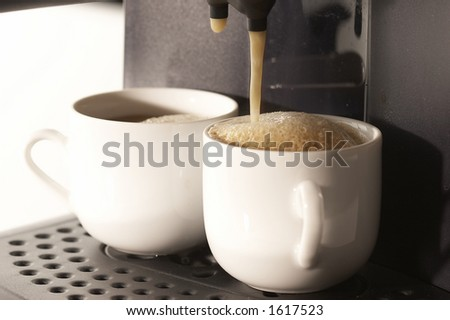 coffee-making machine and cups - stock photo