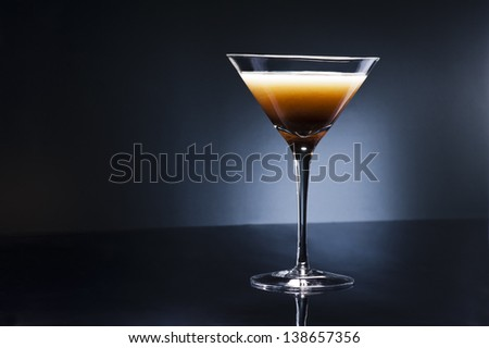Coffee Martini cocktail in front of disco lights - stock photo