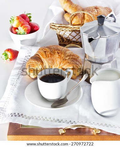 Coffee, milk and fresh croissants.