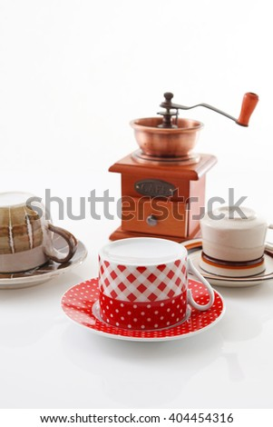 Coffee mill with cups - stock photo