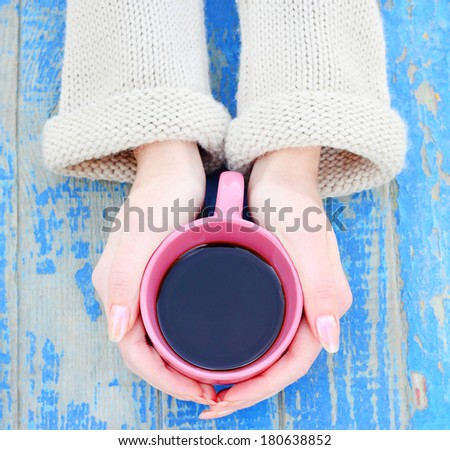 coffee mug in hand - stock photo