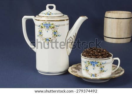 coffee mug on the table with a blue tablecloth, blurred background - stock photo