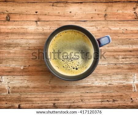 coffee mug on wooden, rustic table - stock photo