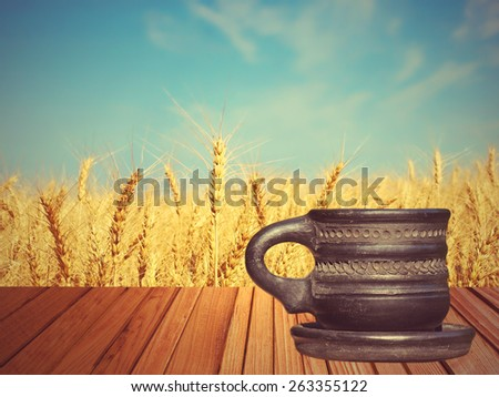 Coffee mug taken closeup on beige background. - stock photo