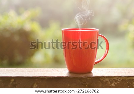 Coffee mug with smoke in natural outdoor - stock photo