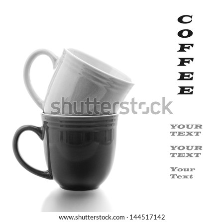 Coffee Mugs Stacked in Black and White on a white background with copyspace - stock photo