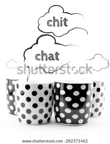 Coffee mugs with speech bubbles Chit chat isolated on white background - stock photo