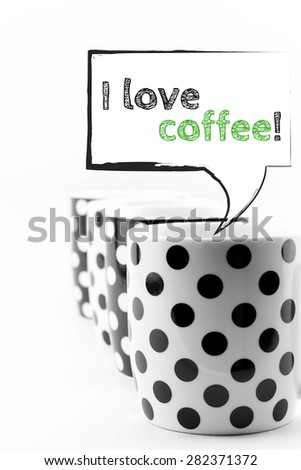 Coffee mugs with speech bubbles I love coffee text isolated - stock photo
