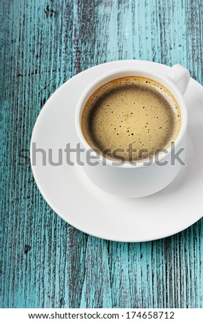 Coffee on a turquoise vintage surface - stock photo