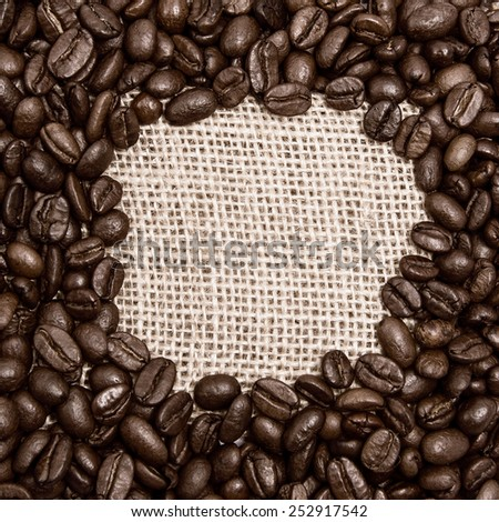 Coffee on burlap background. Round space for the text - stock photo