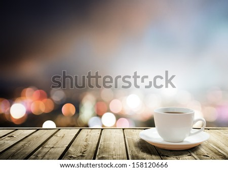 coffee on table in the night city  - stock photo
