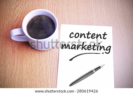 Coffee on the table with note writing content marketing. - stock photo