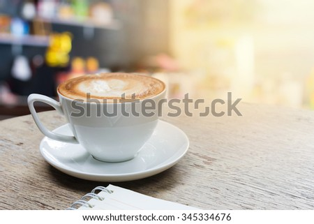 Coffee On Wood Table With Coffee Shop  - stock photo
