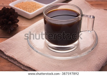 coffee on wooden table. coffee cup. Soft focus.