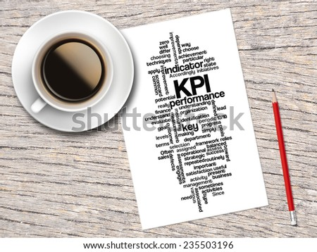 Coffee, Pencil And A Note Contain Word Clouds Of Key Performance Indicator (KPI) And Its Related Words  - stock photo