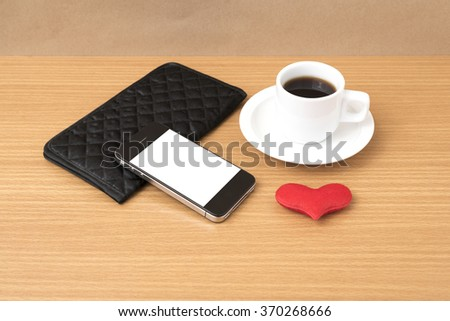 coffee,phone,wallet and heart on wood table background