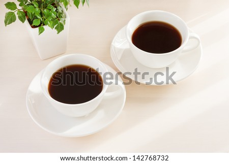 Coffee placed on a desk - stock photo