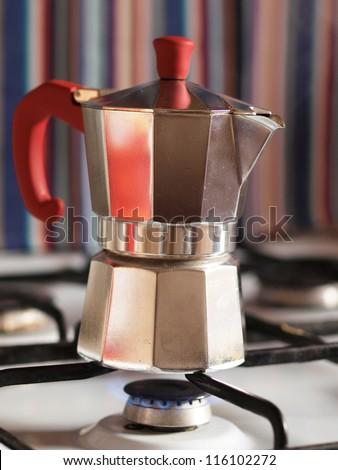 Coffee pot on a gas stove - stock photo