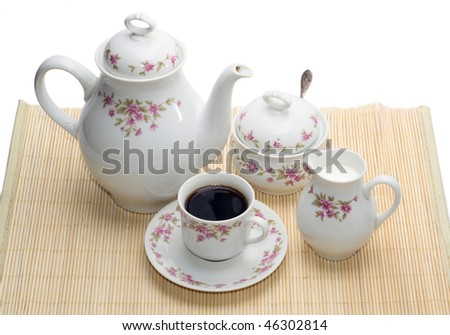 coffee-pot with several objects on the mat - stock photo