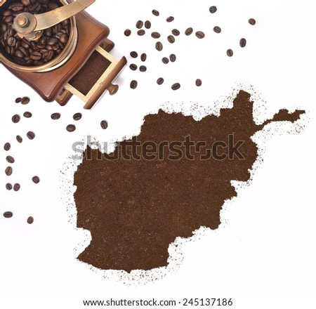 Coffee powder in the shape of Afghanistan and a decorative coffee mill.(series) - stock photo