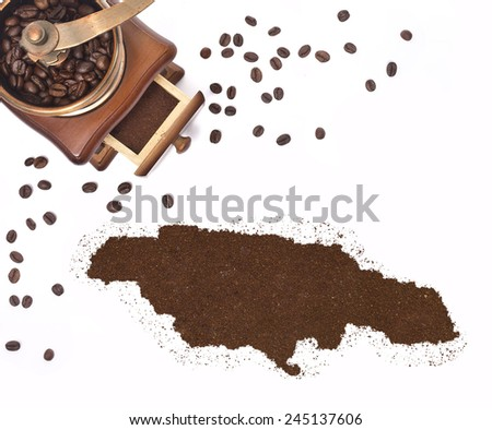 Coffee powder in the shape of Jamaica and a decorative coffee mill.(series) - stock photo