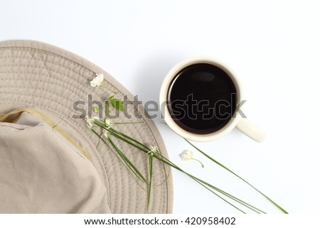 Coffee,safari hat and Small white flowers On a white background