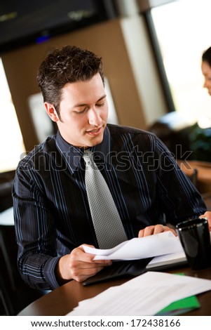 Coffee Shop: Businessman Reviewing Documents