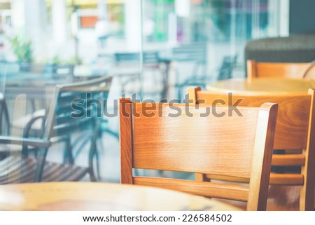 Coffee shop cafe - selective chair in coffee shop process vintage effect style picture - stock photo