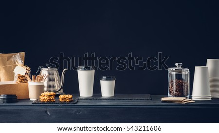 Coffee shop interior, Coffee to go and accessories on the table