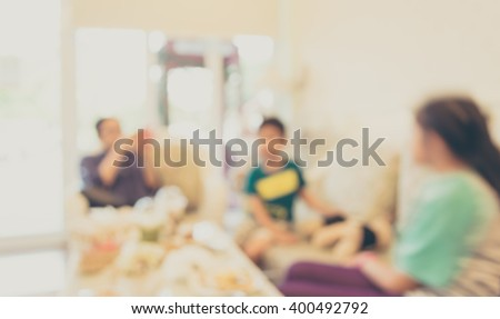 Coffee shop with family blur background with bokeh image .(vintage tone)