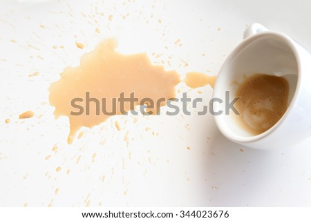 Coffee spill out from the cup - stock photo