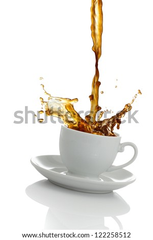 Coffee spilling out of a cup - stock photo