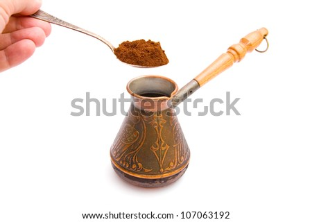 Coffee spoon and cezve isolated on white background - stock photo