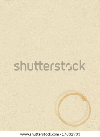 Coffee stain on brown textured paper - stock photo