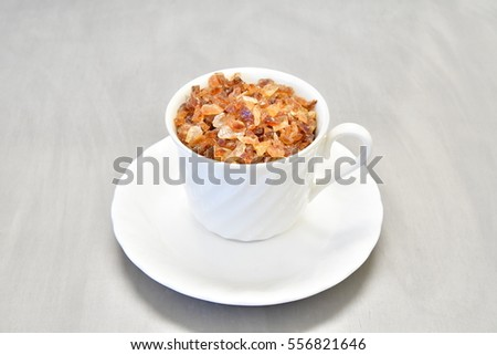 coffee sugar in a cup on the metal background
