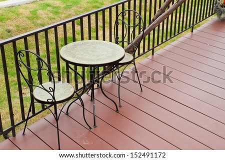 Coffee table in the garden. - stock photo