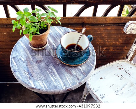 coffee-table, old chair, selective focus and toned image