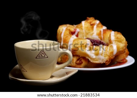 Coffee time with a hot buns. (black background)