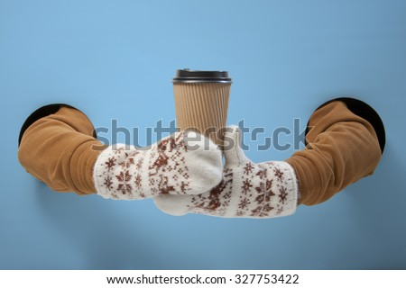 Coffee to go in winter time. Empty for your logo - stock photo
