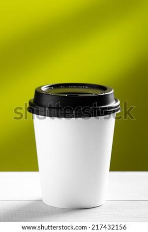 Coffee to go on white table - stock photo